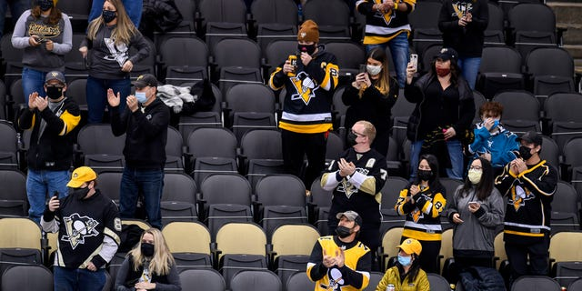 PITTSBURGH, PA - MARCH 02: Social distant fans cheer during the first period in the NHL game between the Pittsburgh Penguins and the Philadelphia Flyers on March 2, 2021, at PPG Paints Arena in Pittsburgh, PA. (Photo by Jeanine Leech/Icon Sportswire via Getty Images)