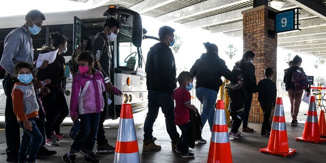 Migrants mostly from Central America are dropped off by the US Customs and Border Protection at a bus station near the Gateway International Bridge, between the cities of Brownsville, Texas, and Matamoros, Mexico, on March 15, 2021, in Brownsville, Texas. (Photo by CHANDAN KHANNA / AFP) (Photo by CHANDAN KHANNA/AFP via Getty Images)