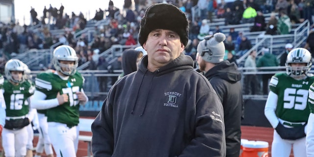 Duxbury High head coach Dave Maimaron on the sidelines against Tewksbury High during the MIAA Division 3 football semifinal at Xaverian Brothers High in Westwood, MA on Nov. 23, 2019. (Photo by Matthew J. Lee/The Boston Globe via Getty Images)