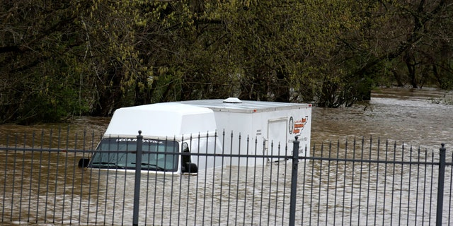 A van and trailer trapped in a parking lot due to local flooding during the weekend of the Food City Dirt Race on March 28, 2021, at Bristol Motor Speedway in Bristol, TN. (Photo by Jeff Robinson/Icon Sportswire via Getty Images)