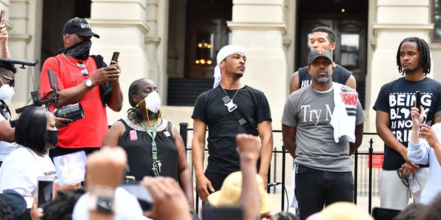 Rapper T.I. says he was arrested in Amsterdam for using a cell phone while bike riding. Photographed here back in June, the rapper attends the Justice For Kendrick Johnson Rally at the Georgia State Capitol on June 13, 2020 in Atlanta, Georgia.