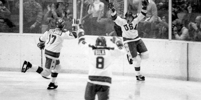 Team USA's Mark Johnson, right, celebrates one of his two goals vs. the Soviet Union during a medal-round game at the 1980 Winter Olympics in Lake Placid, NY., on Friday, Feb. 22, 1980. (Getty Images)