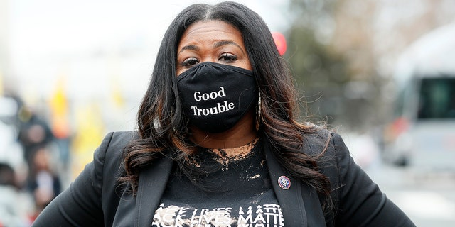 "Rep. Cori Bush (D-MO) attends The National Council for Incarcerated Women and Girls ""100 Women for 100 Women"" rally in Black Lives Matter Plaza near The White House on March 12, 2021. (Photo by Paul Morigi/Getty Images)"