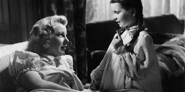 Margaret O'Brien (right) with June Allyson in a scene from the film 'Music For Millions', 1944.