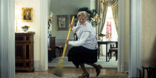Robin Williams sweeps in a scene from the film 'Mrs. Doubtfire', 1993.