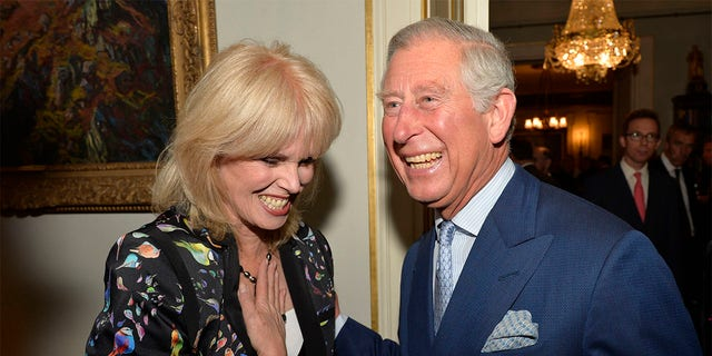 Prince Charles, Prince of Wales greets actress Joanna Lumley as he hosts a reception to mark the 60th anniversary of the charity 'Samaritans', at Clarence House on May 1, 2013, in London.