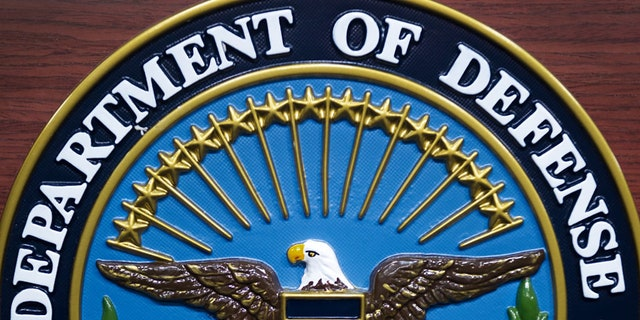 The US Department of Defense(DOD) seal is seen on the lectern in the media briefing room at the Pentagon on December 12, 2013, in Washington, DC. (PAUL J. RICHARDS/AFP via Getty Images)