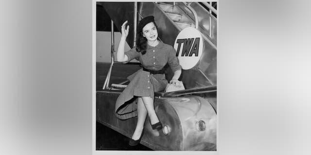 Actress Margaret O'Brien posing next to an airplane at Idlewild Airport, New York, circa 1951.