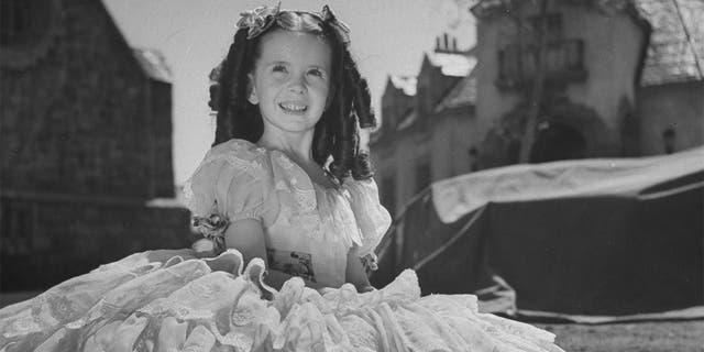 Child film actress Margaret O'Brien on set.
