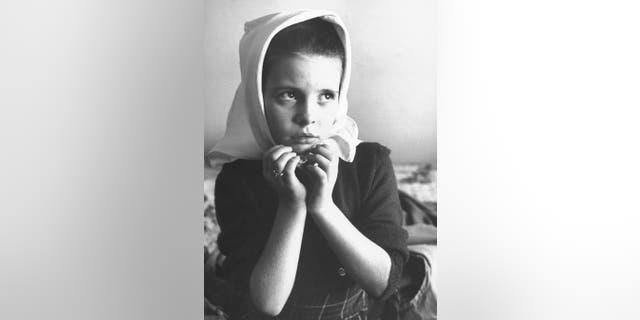 Child star Margaret O'Brien doing an impersonation of actress Jennifer Jones.