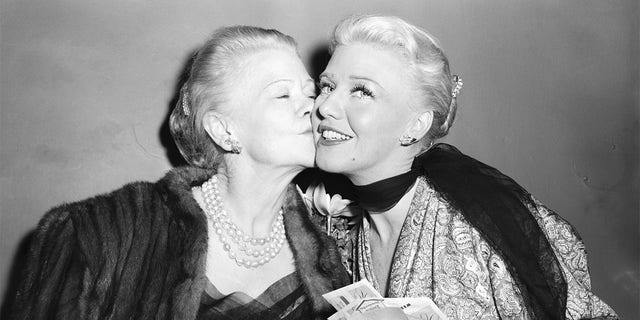 """Actress Ginger Rogers is congratulated by her mother, Lela Rogers, after Ginger's first-night performance in the play """"Love and Let Love."""""""