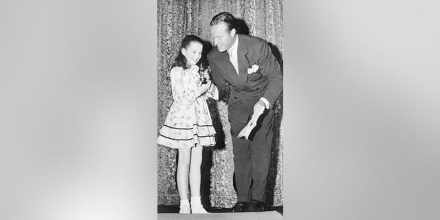 Bob Hope presents Margaret O'Brien with the Academy's first 'Oscarette' in 1944.