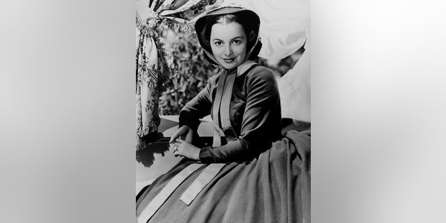 """Actress Olivia de Havilland poses for the Selznick/MGM film """"Gone With the Wind"""" in 1939 in Los Angeles."""