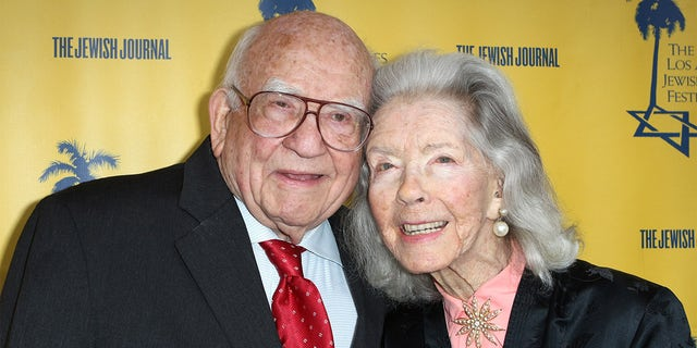 """Ed Asner (L) and Marsha Hunt attend the Los Angeles Jewish Film Festival opening night premiere of """"My Friend Ed"""" at Laemmle's Ahrya Fine Arts Theatre on April 26, 2017, in Beverly Hills, Calif."""
