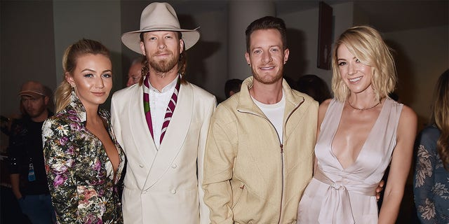 (L-R) Brittney Kelley, Brian Kelley and Tyler Hubbard of Florida Georgia Line, and Hayley Hubbard attend the 2017 CMT Music Awards at the Music City Center on June 7, 2017, in Nashville, Tennessee.