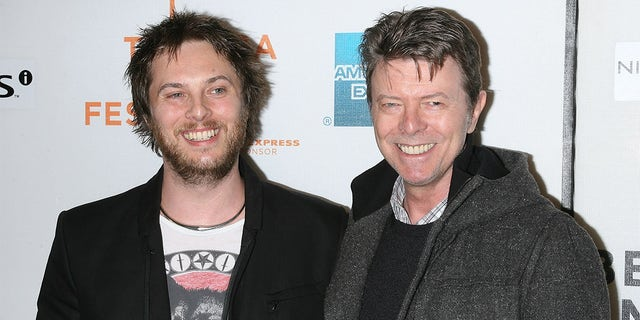 "Director Duncan Jones and Musician David Bowie attend the premiere of ""Moon"" during the 8th Annual Tribeca Film Festival at BMCC Tribeca Performing Arts Center on April 30, 2009, in New York City."