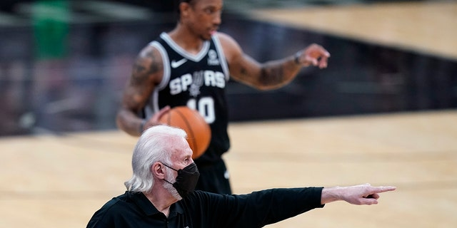 San Antonio Spurs coach Gregg Popovich directs players during the first half of an NBA basketball game against the New Orleans Pelicans in San Antonio, Saturday, Feb. 27, 2021.