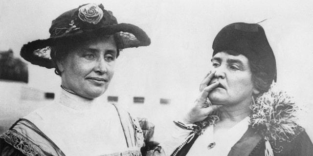 Helen Keller stands with her teacher, Anne Sullivan in 1915