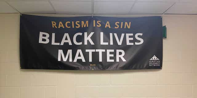A Black Lives Matter banner that hangs in a hallway at Loyola Academy.