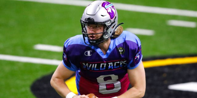 Jackson Erdmann #8 of the Wild Aces rolls out to pass during the second half of a Fan Controlled Football game against the Glacier Boyz at Infinite Energy Arena on March 6, 2021 in Duluth, Georgia. (Photo by Todd Kirkland/Fan Controlled Football/Getty Images)