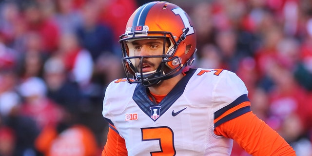 Illinois quarterback Jeff George Jr. looks to the sidelines during game action. George threw four interceptions during the game. Wisconsin beat Illinois 48-3 at Camp Randall Stadium on Nov. 12, 2016, in Madison, Wis.