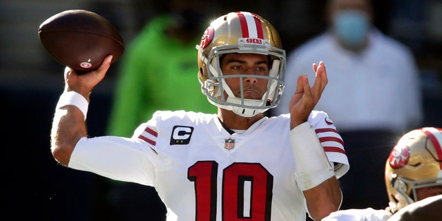 FILE - In this Sunday, Nov. 1, 2020, file photo, San Francisco 49ers quarterback Jimmy Garoppolo passes against the Seattle Seahawks during the first half of an NFL football game in Seattle. (AP Photo/Scott Eklund, File)