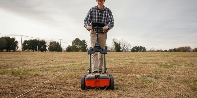 Geophysicist Dr. Timothy J. Horsley conducting the ground-penetrating radar survey (Credit: Historic St. Mary's City)