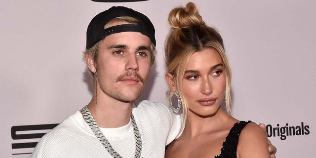 Justin Bieber and Hailey Baldwin got matching peach tattoos in honor of his history-making single 'Peaches.' (Photo by Alberto E. Rodriguez/Getty Images)