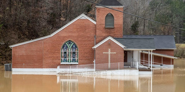 Flood waters surround Rockhouse Freewill Baptist Church in Johnson County, Ky., Monday, March 1, 2021. Heavy rain across Appalachia has led to water rescues, mudslides, road closures and power outages, officials said. (Ryan C. Hemens/Lexington Herald-Leader via AP)