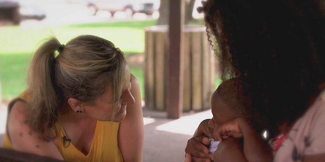 This Feb. 24, 2021 photo provided by the Lane Thomas Foundation shows Lauressa Gillock, left, of North Platte, Nebraska, meeting with a Mississippi boy, KeVon Long, in Louisiana, who received her daughter's heart after her organs were donated. Gillock is part of a campaign the Lane Thomas Foundation organized to promote pediatric organ donation. (Lane Thomas Foundation via AP)