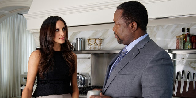 Meghan Markle and Wendell Pierce in 'Suits.' (Photo by: Ben Mark Holzberg/USA Network/NBCU Photo Bank/NBCUniversal via Getty Images)