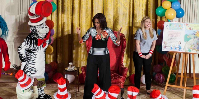 "First Lady Michelle Obama dances with local students in the East Room of the White House after reading them Dr. Seuss' ""Oh, The Things You Can Do That Are Good for You!"" as part of her ""Let's Move, Let's Read!"" initiative in Washington, D.C. on January 21, 2015. (Photo by Samuel Corum/Anadolu Agency/Getty Images)"