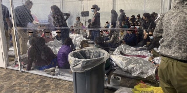 Photo of migrants in a Customs and Border Protection temporary overflow facility in Donna, Texas, being held in clear pens akin to cages. (Office of Rep. Henry Cuellar, D-Texas)