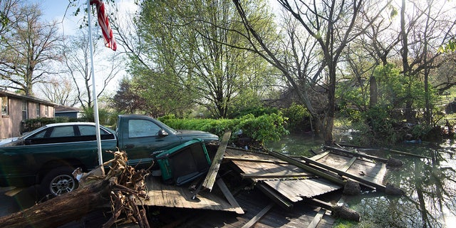 Debris lies in the backyard yard outside a home in Nashville on Sunday. Flash flooding along Sevenmile Creek the night before caused major damage in the South Nashville neighborhood. (Reuters)