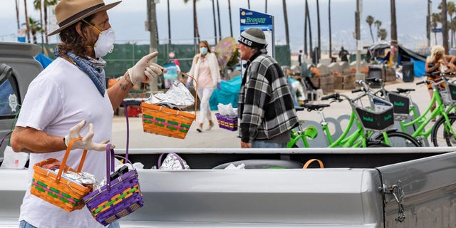 Celebrity men's groomer Jason Schneidman giving out Easter baskets full of supplies to the homeless in Venice, California.