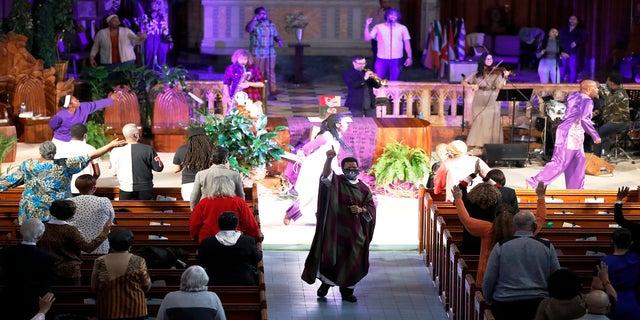 Pastor Thulani Magwaza leads the Sunday church service at St. Sabina Catholic Church on March 7. (AP)