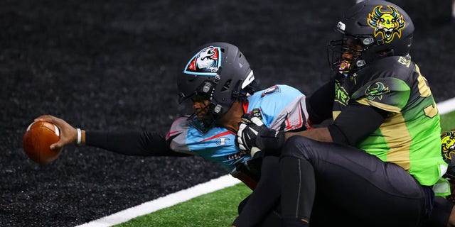 David Pindell #11 of the Glacier Boyz scores a touchdown against Owen Obasuyi #97 of the Beasts during a Fan Controlled Football game at Infinite Energy Arena on February 27, 2021 in Duluth, Georgia. (Photo by Kevin C. Cox/Fan Controlled Football/Getty Images)