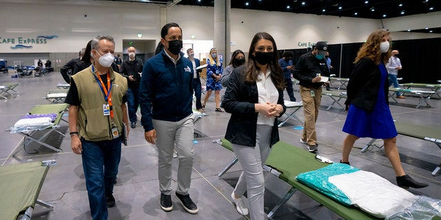 San Diego Mayor Todd Gloria along with other officials are among the group of elected officials who were given a tour of the temporary youth shelter at the center, Saturday, March 27, 2021 in San Diego. (Nelvin C. Cepeda/The San Diego Union-Tribune via AP)