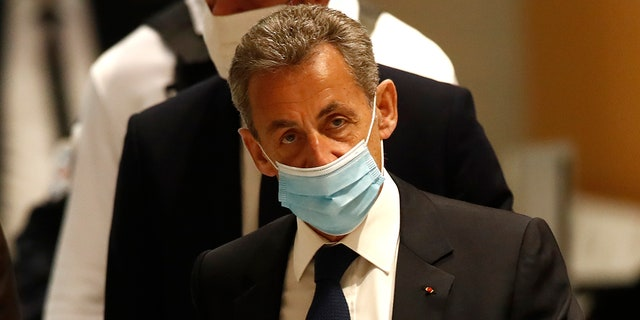 Former French President Nicolas Sarkozy arrives at the courtroom Monday, March 1, 2021 in Paris. (AP Photo/Michel Euler)
