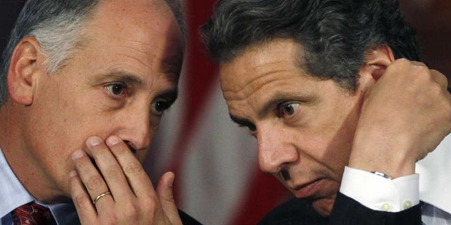Larry Schwartz, left, a top aide to New York Gov. Andrew Cuomo, resigned this week, according to reports.