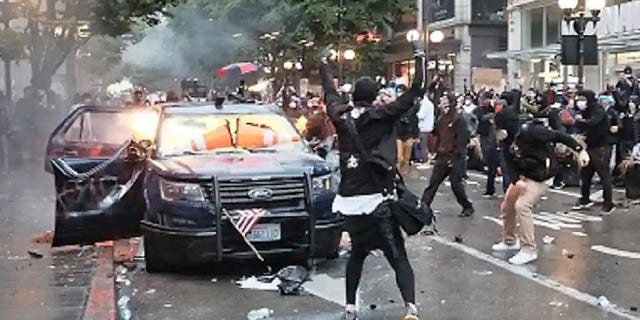 Kelly Thomas Jackson, 20, was sentenced to prison last month for allegedly throwing Molotov cocktails at two Seattle police vehicles during a May 30 protest that devolved into a riot.