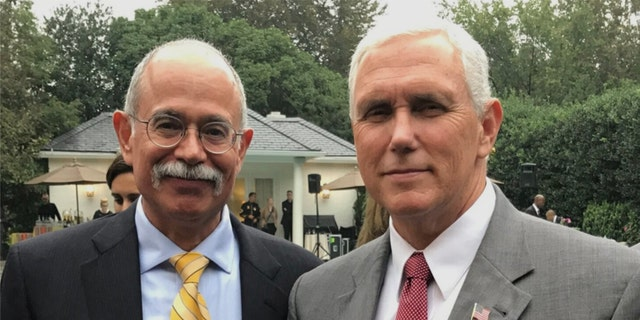 Retired Army Col. Sergio De La Peña (L) and former Vice President Mike Pence (R). (Courtesy Sergio de la Peña for Virginia Governor)