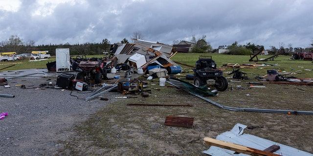 Debris litters weather-damaged properties at the intersection of County Road 24 and 37 in Clanton, Ala., the morning following a large outbreak of severe storms across the southeast, Thursday, March 18, 2021.