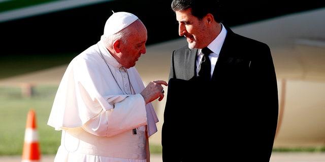 Kurdish President Nechirvan Barzani, right, greets Pope Francis upon his arrival in Irbil international airport, Iraq, Sunday, March 7, 2021. (Associated Press)