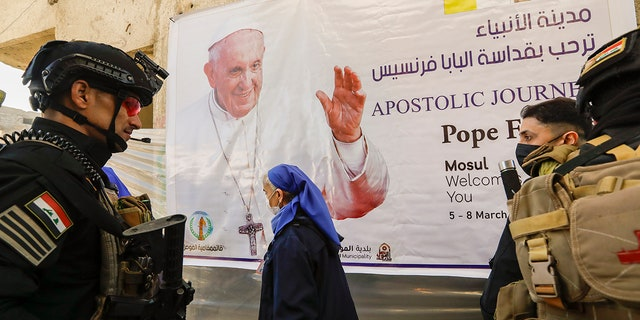 Iraqi security forces deploy in Mosul, northern Iraq, once the de-facto capital of IS, where Pope Francis will pray for the victims of war at Hosh al-Bieaa Church Square, Sunday, March 7, 2021. (Associated Press)