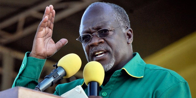 FILE - In this Friday, Oct. 23, 2015 file photo, President John Magufuli gestures during an election rally in Dar es Salaam, Tanzania. (AP Photo/Khalfan Said, File)