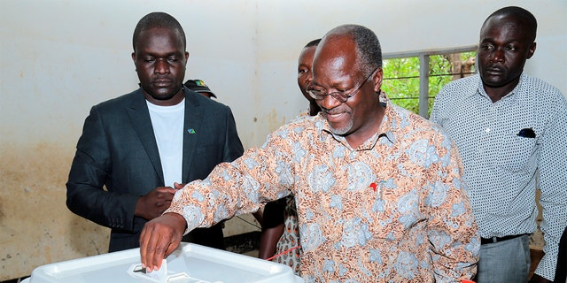 FILE - In this Sunday, Oct. 25, 2015 file photo, Tanzania's ruling party presidential candidate John Magufuli casts his vote in his home town of Chato, northern Tanzania. (AP Photo, File)