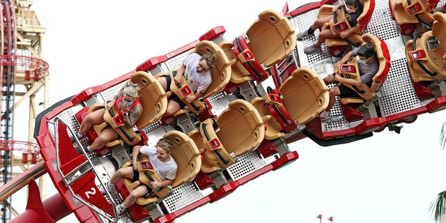 """The California Amusement Park Association is requiring its members to modify seating on rides in order to""""mitigate the effect of shouting."""" Parks in other parts of the country, such as Universal Studios Orlando, are already enforcing physical-distancing requirements between groups or parties on rides. (Gregg Newton/AFP via Getty Images)"""