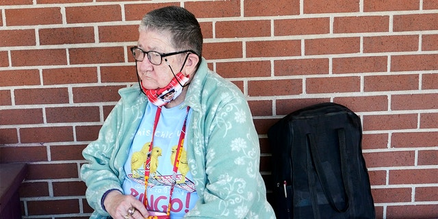 Pat Brown waits outside the Don Bosco Senior Center in Kansas City, Mo., Wednesday, March 3, 2021.  (AP Photo/Orlin Wagner)
