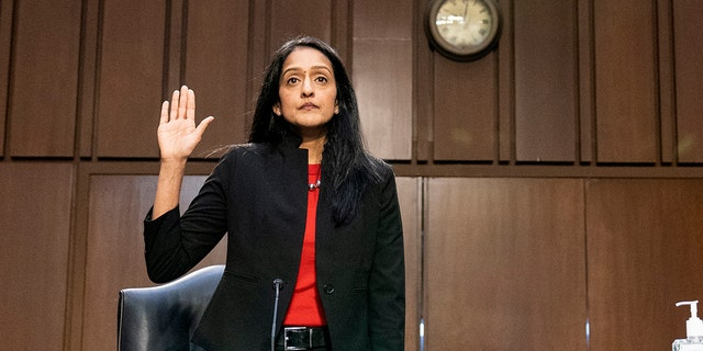Vanita Gupta, nominated to be Associate Attorney General, is sworn in before a hearing of the Senate Judiciary Committee on Capitol Hill, Tuesday, March 9, 2021, in Washington. (AP Photo/Alex Brandon)